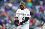 Colorado Rockies starting pitcher German Marquez hits his glove after giving up two runs to the Cincinnati Reds in the third inning of a baseball game Friday, May 14, 2021, in Denver. (AP Photo/David Zalubowski)