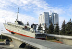The building and the torpedo boat, the Baltic Sailors Memorial, in Kaliningrad, Russia, Thursday, Oct. 29, 2020. The hulking never-occupied building sardonically likened to a robot's head that has loomed over the city of Kaliningrad for decades is to be demolished next year, the region's governor says. The 21-story House of Soviets was left unfinished when funding ran out in 1985 amid the Soviet Union's economic struggles and later was assessed to be structurally unsound. (AP Photo/James Heintz)