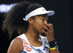 Japan's Naomi Osaka reacts during her third round singles match against Coco Gauff of the U.S. at the Australian Open tennis championship in Melbourne, Australia, Friday, Jan. 24, 2020. (AP Photo/Lee Jin-man)