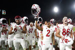 Utah players celebrate a win over Southern California in an NCAA college football game Saturday, Oct. 9, 2021, in Los Angeles. (AP Photo/Marcio Jose Sanchez)