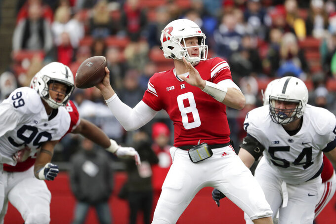 Rutgers quarterback Artur Sitkowski (8) looks to pass as Penn State defensive end Yetur Gross-Matos (99) and defensive tackle Robert Windsor (54) rush in during the first half of an NCAA college football game, Saturday, Nov. 17, 2018, in Piscataway, N.J. (AP Photo/Julio Cortez)