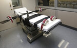 FILE - This Oct. 9, 2014, file photo shows the gurney in the the execution chamber at the Oklahoma State Penitentiary in McAlester, Okla. Oklahoma is planning to resume executing death-row inmates, five years after lethal injections were put on hold following a series of death-chamber mishaps, state officials announced Thursday, Feb. 13, 2020. (AP Photo/Sue Ogrocki, File)