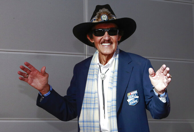 NASCAR great Richard Petty arrives for the NASCAR Hall of Fame induction ceremony Friday, Feb. 1, 2019, in Charlotte, N.C. (AP Photo/Jason E. Miczek)