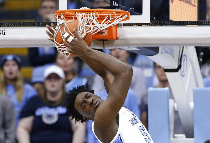North Carolina's Nassir Little dunks during the second half of the team's NCAA college basketball game against Notre Dame in Chapel Hill, N.C., Tuesday, Jan. 15, 2019. North Carolina won 75-69. (AP Photo/Gerry Broome)