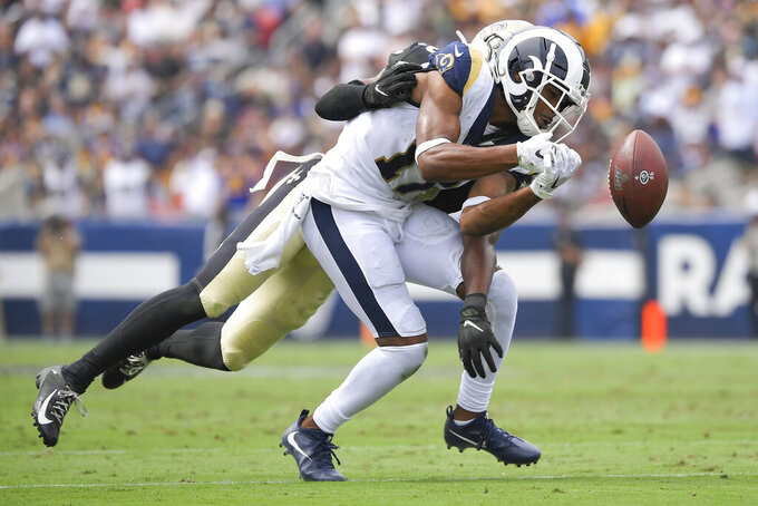 New Orleans Saints cornerback Eli Apple, back, breaks up a pass intended for Los Angeles Rams wide receiver Robert Woods during the first half of an NFL football game Sunday, Sept. 15, 2019, in Los Angeles. (AP Photo/Mark J. Terrill)