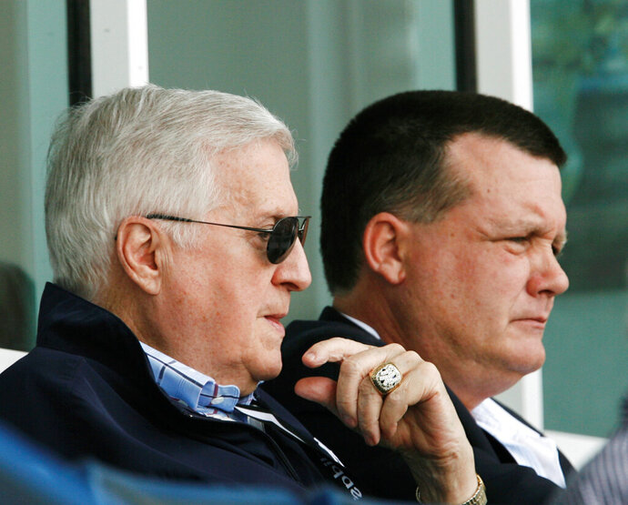 FILE - In this March 11, 2008, file photo, New York Yankees principal owner George Steinbrenner, left, and his son, Yankees general partner Hank Steinbrenner, watch the Yankees play the Toronto Blue Jays in a spring baseball game at Legends Field in Tampa, Fla. Henry