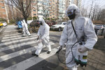 South Korean army soldiers spray disinfectant as a precaution against a new coronavirus on a street in Seoul, South Korea, Monday, March 9, 2020. (AP Photo/Ahn Young-joon)