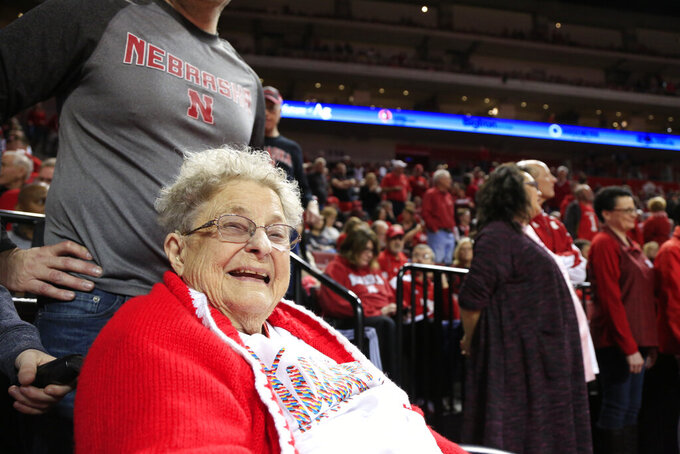 98-year-old Florence Dalby smiles at half time of an NCAA college basketball game between Ohio State and Nebraska, in Lincoln, Neb., Saturday, Jan. 26, 2019. Dalby is a University of Nebraska Lincoln graduate and has had a men's basketball season ticket for more than 80 years. Dalby loves Nebraska as much today as she did when she first started going to games in 1939. The Cornhuskers honored her during their Coaches Vs. Cancer game against Ohio State. (AP Photo/Nati Harnik)