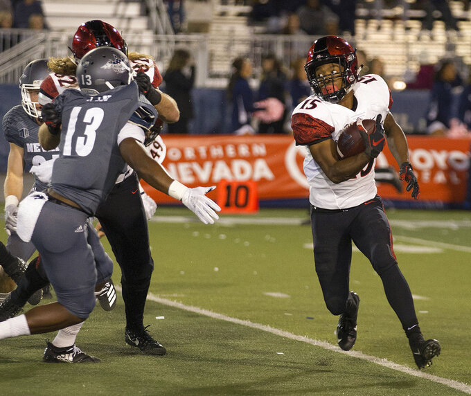 San Diego State running back Jordan Byrd runs against Nevada in the first half of an NCAA college football game in Reno, Nev., Saturday, Oct. 27, 2018. (AP Photo/Tom R. Smedes)