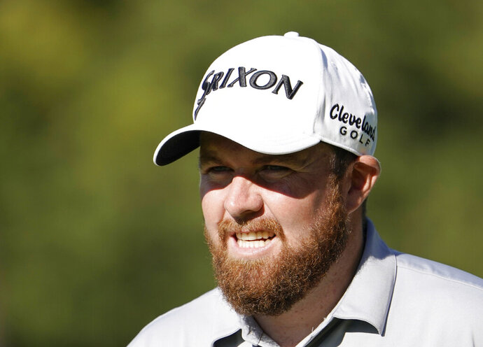 FILE - In this file photo dated Wednesday, Oct. 23, 2019, Shane Lowry of Ireland walks onto the 9th hole during the pro-am event of the Zozo Championship PGA Tour at Accordia Golf Narashino C.C. in Inzai, east of Tokyo, Japan.  Lowry won the first major title of his career in the middle of 2019, and is now trying to end the year as Europe's No. 1 golfer, as he heads for the Race to Dubai championship and the last event of the season on the European Tour. (AP Photo/Lee Jin-man, FILE)