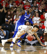 Cincinnati guard Jarron Cumberland, bottom, falls as he tries to control the ball in front of Memphis guard Raynere Thornton during the second half of an NCAA college basketball game Saturday, March 2, 2019, in Cincinnati. Cincinnati won 71-69. (AP Photo/Gary Landers)