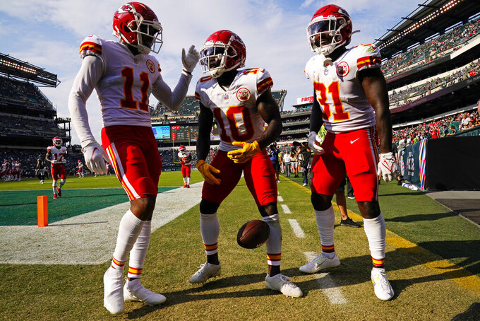 Kansas City Chiefs wide receiver Tyreek Hill (10) celebrates after his touchdown with teammates Demarcus Robinson (11) and KDarrel Williams (31) during the second half of an NFL football game Sunday, Oct. 3, 2021, in Philadelphia. (AP Photo/Matt Rourke)
