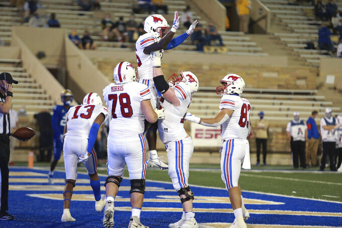 SMU celebrates a touchdown against Tulsa during the first half of an NCAA college football game in Tulsa, Okla., Saturday, Nov. 14, 2020. (AP Photo/Joey Johnson)