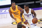 Sacramento Kings guard Davion Mitchell, right, drives against Los Angeles Lakers guard Justin Robinson during the first half of an NBA summer league basketball game in Sacramento, Calif., Wednesday, Aug. 4, 2021. (AP Photo/Rich Pedroncelli)
