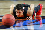 Texas Tech's Davide Moretti warms up during a practice session for the semifinals of the Final Four NCAA college basketball tournament, Friday, April 5, 2019, in Minneapolis. (AP Photo/Charlie Neibergall)