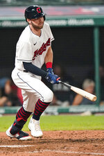 Cleveland Indians' Owen Miller watches his RBI single during the sixth inning of the team's baseball game against the Texas Rangers, Wednesday, Aug. 25, 2021, in Cleveland. (AP Photo/Tony Dejak)