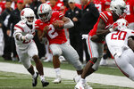 Ohio State running back J.K. Dobbins, center, cuts up field in front of Rutgers defensive back Damon Hayes during the first half of an NCAA college football game Saturday, Sept. 8, 2018, in Columbus, Ohio. (AP Photo/Jay LaPrete)