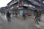 Indian paramilitary soldiers patrol a deserted street during the second phase of India's general elections, in Srinagar, Indian controlled Kashmir, Thursday, April 18, 2019. Kashmiri separatist leaders who challenge India's sovereignty over the disputed region have called for a boycott of the vote. Most polling stations in Srinagar and Budgam areas of Kashmir looked deserted in the morning with more armed police, paramilitary soldiers and election staff present than voters. (AP Photo/ Dar Yasin)