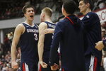 Gonzaga forward Filip Petrusev (3) celebrates with guard Martynas Arlauskas, second from left, and teammates during the second half of an NCAA college basketball game against Santa Clara in Santa Clara, Calif., Thursday, Jan. 30, 2020. (AP Photo/Jeff Chiu)