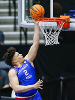 Louisiana Tech forward Kenneth Lofton Jr. lays up the ball during the first half of the team's NCAA college basketball game against Mississippi in the NIT, Friday, March 19, 2021, in Frisco, Texas. (AP Photo/Brandon Wade)