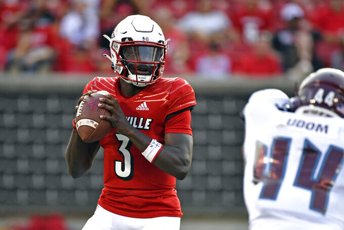 Louisville quarterback Malik Cunningham (3) looks for an open receiver during the first half of an NCAA college football game against Eastern Kentucky in Louisville, Ky., Saturday, Sept. 11, 2021. (AP Photo/Timothy D. Easley)