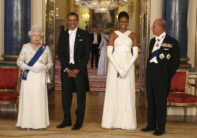 FILE - In this Tuesday May 24, 2011 file photo, Britain's Queen Elizabeth II, U.S. President Barack Obama, first lady Michelle Obama and Prince Philip ahead of a state banquet in Buckingham Palace, London. Buckingham Palace officials say Prince Philip, the husband of Queen Elizabeth II, has died, it was announced on Friday, April 9, 2021. He was 99. Philip spent a month in hospital earlier this year before being released on March 16 to return to Windsor Castle. Philip, also known as the Duke of Edinburgh, married Elizabeth in 1947 and was the longest-serving consort in British history.  (AP Photo/Chris Jackson, Pool, File)