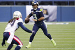 Seattle Seahawks quarterback Russell Wilson looks to pass against the New England Patriots during the first half of an NFL football game, Sunday, Sept. 20, 2020, in Seattle. (AP Photo/Elaine Thompson)