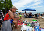 Jomar Gomez, 25, of Jamestown, N.Y., spends time for the July Fourth weekend at Beach 6, Presque Isle State Park, near Erie, Pa., Saturday, July 4, 2020. (Jack Hanrahan/Erie Times-News via AP)