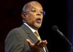 FILE - In this Oct. 2, 2013 file photo, Harvard University professor Henry Louis Gates, Jr., addresses the audience during an award ceremony for the W.E.B. Du Bois Medal at Harvard University, in Cambridge, Mass. Gates said he hopes this season of his popular PBS series