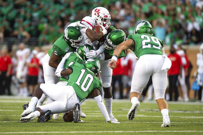 North Texas defense attempt to take down Houston wide receiver Bryson Smith (1) during the first half of an NCAA college football game against  on Saturday, Sept. 28, 2019, in Denton, Texas.  (Kara Dry/The Denton Record-Chronicle via AP)