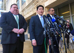 U.S. Attorney Robert Hur, center, of the District of Maryland, speaks as Art Walker, left, special agent from the Coast Guard investigative service, and Gordon Johnson, special agent in charge of the FBI's Baltimore office, listen during a news conference about Coast Guard Lt. Christopher Paul Hasson, Thursday, Feb. 21, 2019, outside the federal courthouse in Greenbelt, Md. Hasson is suspected of drawing up a hit list of top Democrats and network TV journalists spent hours on his work computer researching the words and deeds of infamous bombers and mass shooters while also stockpiling weapons, federal prosecutors said Thursday.  (AP Photo/Michael Kunzelman)