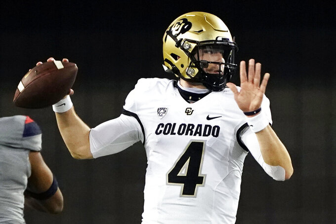 FILE - Colorado quarterback Sam Noyer (4) looks to pass against Arizona in the first half of an NCAA college football game against Arizona in Tucson, Ariz., in this Saturday, Dec. 5, 2020, file photo. Noyer has entered the transfer portal for a second time to close a career in Boulder that included three head coaches and a brief switch to safety. Noyer led the Buffaloes to a 4-2 record last season under first-year Colorado coach Karl Dorrell and a berth in the Alamo Bowl.(AP Photo/Rick Scuteri, File)