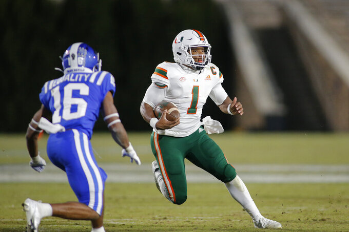 Miami quarterback D'Eriq King (1) carries the football as Duke safety Jaylen Stinson (16) defends during the second half of an NCAA college football game Saturday, Dec. 5, 2020, in Durham, N.C. (Nell Redmond/Pool Photo via AP)