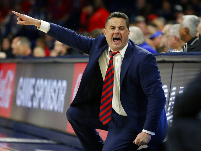 FILE - In this Jan. 5, 2019, file photo, Arizona head coach Sean Miller reacts to a foul call in the first half of an NCAA college basketball game against Utah in Tucson, Ariz. Ranked No. 21 in the Associated Press preseason poll, Arizona lost four key players from last year's team, but gained eight newcomers, including another stellar recruiting class by coach Miller. (AP Photo/Rick Scuteri, File)