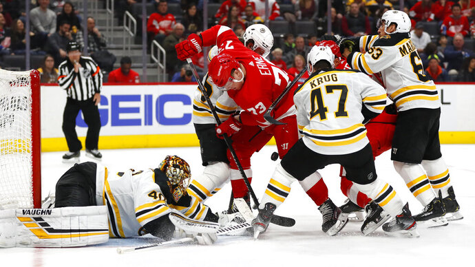 Boston Bruins goaltender Tuukka Rask (40) stops a Detroit Red Wings left wing Adam Erne (73) shot in the second period of an NHL hockey game Sunday, Feb. 9, 2020, in Detroit. (AP Photo/Paul Sancya)