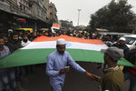 Indian Muslims carry a giant Indian flag during a protest against a new Citizenship law, after Friday prayers in New Delhi, India, Friday, Jan. 17, 2020. Protests against India's citizenship law that excludes Muslim immigrants continue in Indian cities in an unabating strong show of dissent against the Hindu nationalist government of Prime Minister Narendra Modi. (AP Photo/Manish Swarup)