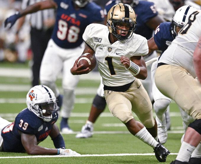 Army quarterback Jabari Laws (1) runs during the first half of an NCAA college football game against UTSA, Saturday, Sept. 14, 2019 in San Antonio. (AP Photo/Darren Abate)