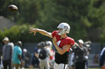 Oakland Raiders quarterback Derek Carr throws during NFL football training camp Wednesday, Aug. 7, 2019, in Napa, Calif. Both the Oakland Raiders and the Los Angeles Rams held a joint practice before their upcoming preseason game on Saturday. (AP Photo/Eric Risberg)