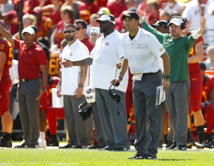 Iowa State head coach Matt Campbell, right, disputes a flag with an official during the second half of an NCAA college football game against Oklahoma, Saturday, Sept. 15, 2018, in Ames, Iowa. Oklahoma won 37-27. (AP Photo/Matthew Putney)