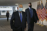 Senate Majority Leader Mitch McConnell, R-Ky., arrives for a closed-door meeting with Senate Republicans, on Capitol Hill in Washington, Friday, Oct. 23, 2020. McConnell says there's nothing the public needs to know about his health after photos showed what appears to be bruising on his hands and around his mouth. (AP Photo/J. Scott Applewhite)