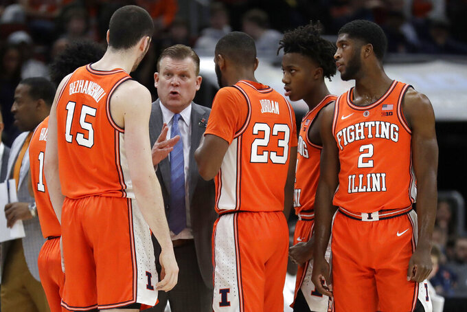 File-This March 14, 2019, file photo shows Illinois head coach Brad Underwood talking to his players during the first half of an NCAA college basketball game against the Iowa in the second round of the Big Ten Conference tournament, in Chicago. A young, maturing Illinois team is hoping for a breakthrough this season, the kind coach Underwood saw coming when he arrived in Champaign two years ago. (AP Photo/Nam Y. Huh, File)