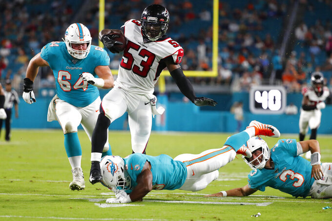 Atlanta Falcons linebacker Jermaine Grace (53) runs after intercepting a pass thrown by Miami Dolphins quarterback Josh Rosen (3) during the first half of a preseason NFL football game Thursday, Aug. 8, 2019, in Miami Gardens, Fla. (AP Photo/Wilfredo Lee)