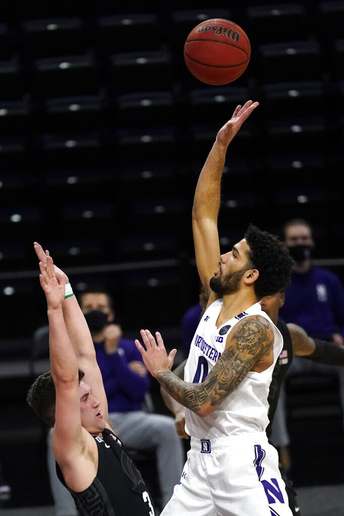 Northwestern guard Boo Buie, right, shoots over Michigan State guard Foster Loyer during the second half of an NCAA college basketball game in Evanston, Ill., Sunday, Dec. 20, 2020. Northwestern won 79-65. (AP Photo/Nam Y. Huh)