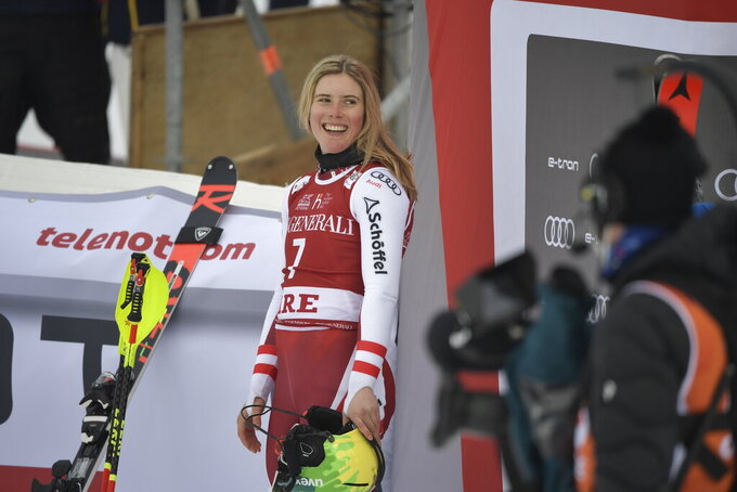 Katharina Liensberger of Austria smiles after after after crossing the finish line after the second run of the women's slalom race of the FIS Ski Alpine World Cup in Are, Sweden, Saturday, March 13, 2021. (Pontus Lundahl/TT News Agency via AP)