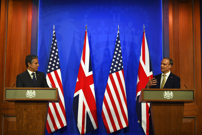 Britain's Foreign Secretary Dominic Raab, right, and US Secretary of State Antony Blinken attend a joint press conference at Downing Street in London, Monday, May 3, 2021, during the G7 foreign ministers meeting. (Ben Stansall/Pool Photo via AP)