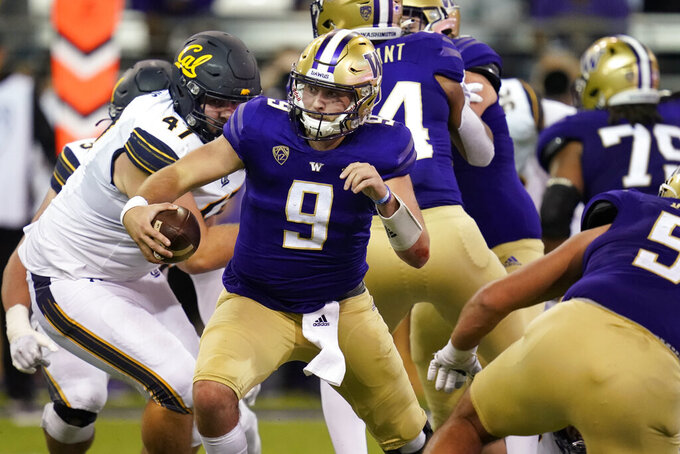 Washington quarterback Dylan Morris (9) scrambles against California in the second half of an NCAA college football game Saturday, Sept. 25, 2021, in Seattle. (AP Photo/Elaine Thompson)