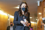 New Zealand Prime Minister Jacinda Ardern walks to her COVID-19 response and vaccine update in Wellington, New Zealand, Thursday, Aug. 26, 2021. By early next week, New Zealanders should know if their government's strict new lockdown is working to stamp out its first coronavirus outbreak in six months. A successful effort could again make the nation's virus response the envy of the world. (Mark Mitchell/Pool Photo via AP)
