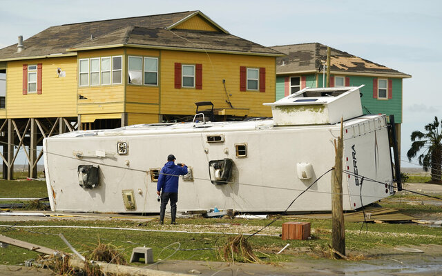 A journalist photographs damage left in the wake of Hurricane Laura, Thursday, Aug. 27, 2020, in Holly Beach, La. (AP Photo/Eric Gay)