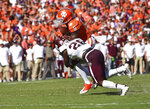 Clemson's Tee Higgins (5) catches a pass while defended by Texas A&M's Demani Richardson during the first half of an NCAA college football game Saturday, Sept. 7, 2019, in Clemson, S.C. (AP Photo/Richard Shiro)