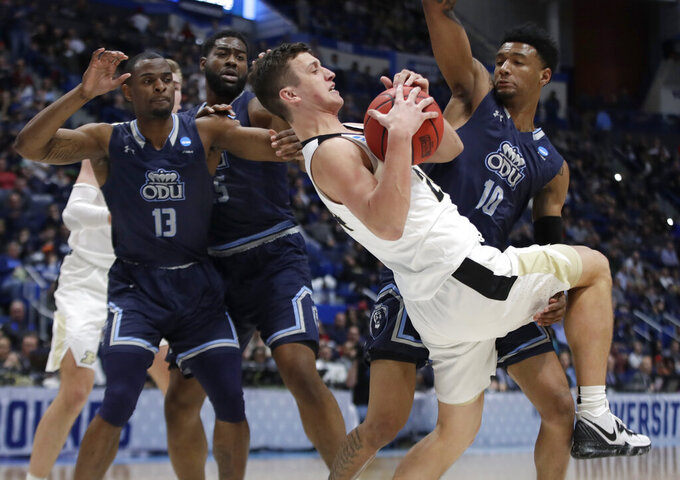 Purdue's Grady Eifert (24) pulls down and controls a rebound against Old Dominion's Aaron Carver (13), Joseph Reece (15) and Xavier Green (10) during the first half of a first round men's college basketball game in the NCAA Tournament, Thursday, March 21, 2019, in Hartford, Conn. (AP Photo/Elise Amendola)